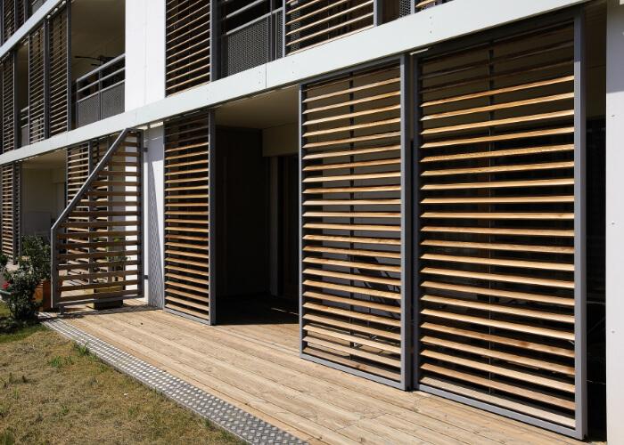Loggia - vertical wood sliding panels/ shutters RENSON (Belgium)